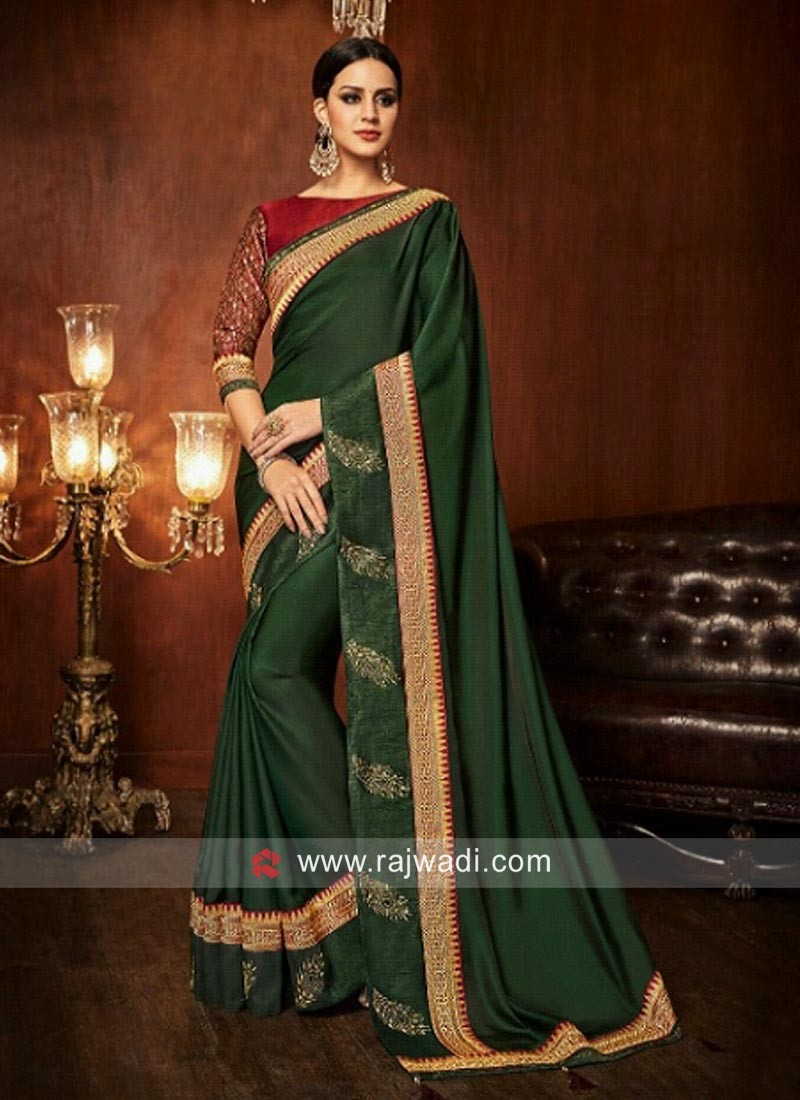 42b43b47dd9371 Dark Green Saree with Red Blouse. Hover to zoom