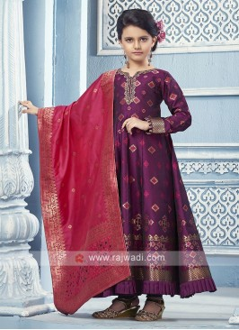 Dark magenta Anarkali with contrast dupatta.
