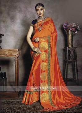 Dark Orange Saree with Navy Blue Blouse
