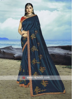 Dark peacock blue Art silk saree with contrast blouse.