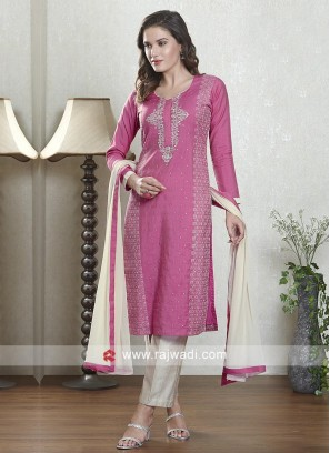 Dark pink and skin color salwar suit