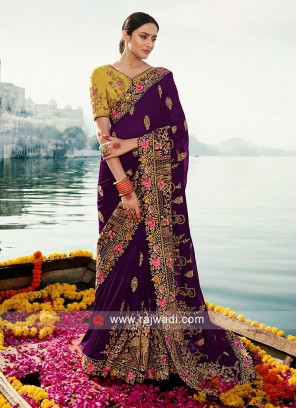 Dark purple Art silk saree with contrast blouse.