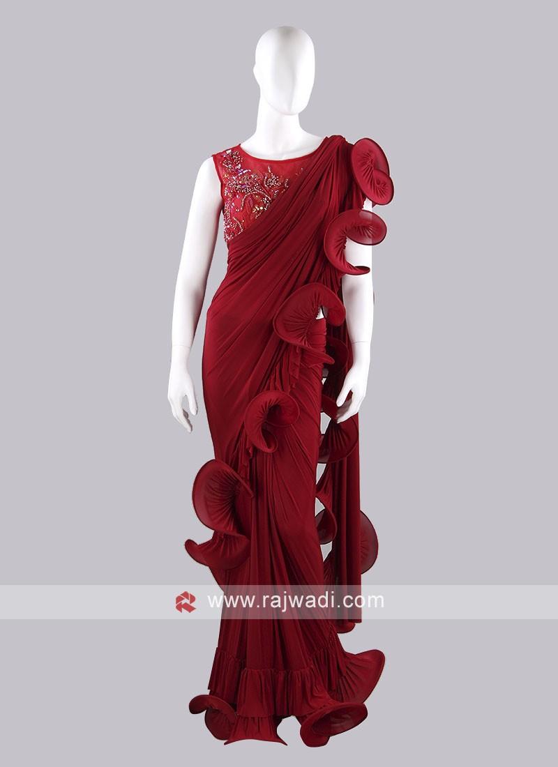 Dark red color ruffle saree