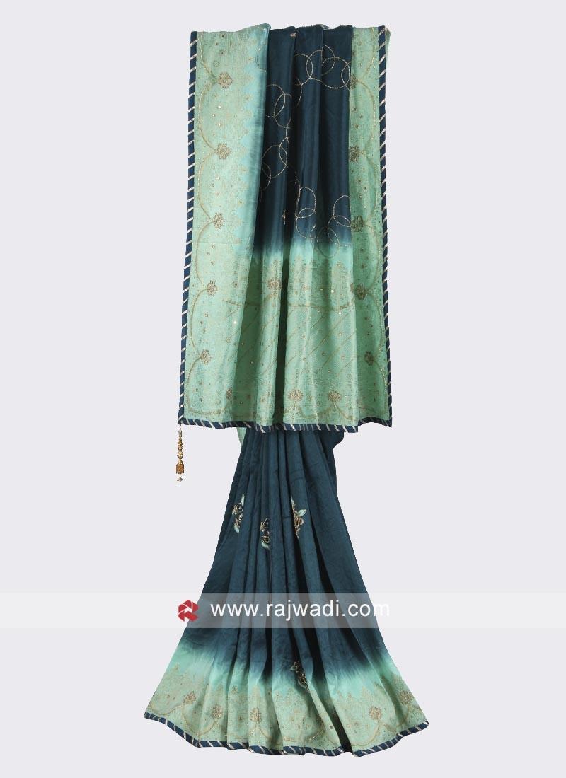 Dark teal and sea green color silk saree