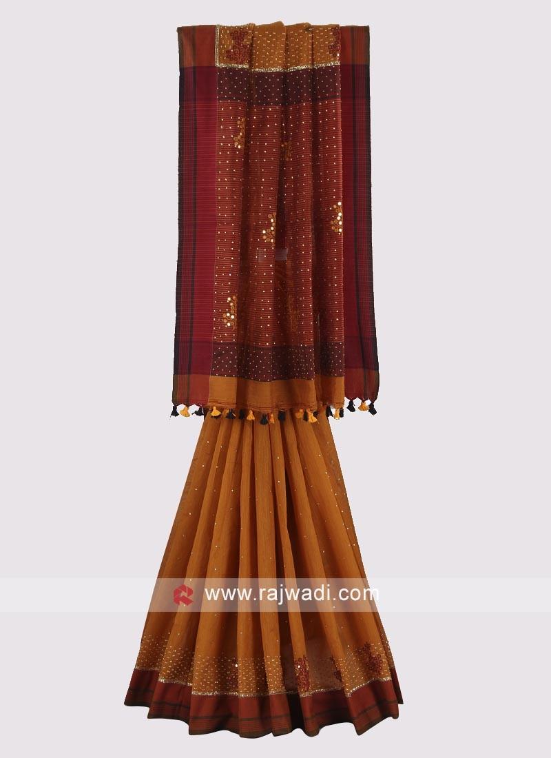 Dark yellow and maroon color jute silk saree