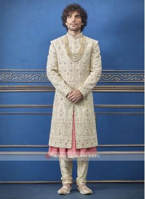 Designer cream and peach sherwani