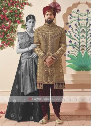 designer golden and maroon sherwani