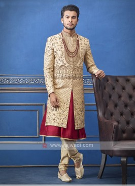 Designer golden and red groom sherwani