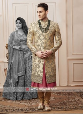 designer golden colour sherwani