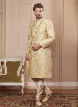 designer golden cream colour sherwani