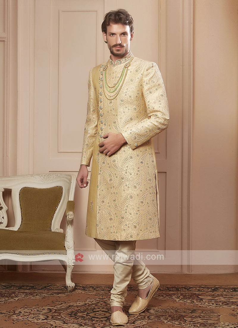 designer golden cream colour sherwani