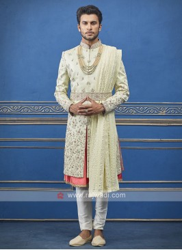 Designer pista green and orange sherwani