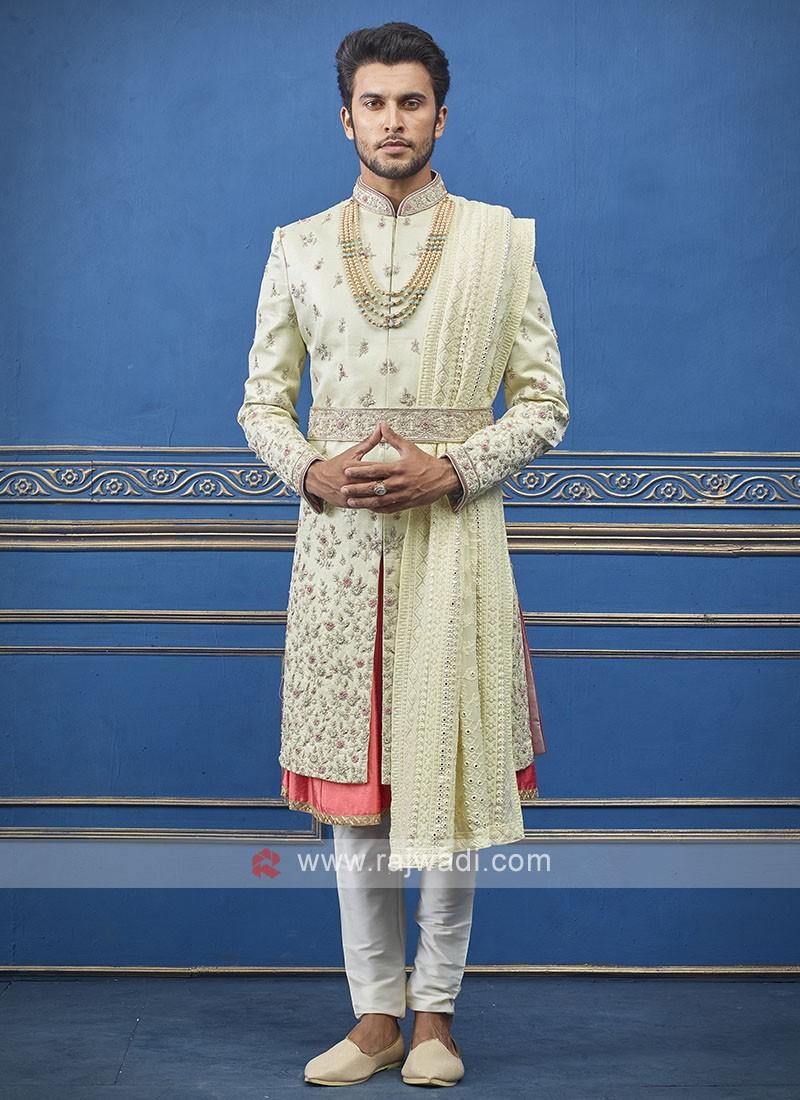 Designer pista green and orange sherwani