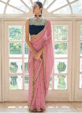 Distinctively Faux Georgette Peach Zari Classic Designer Saree