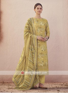 Dola silk suit in mehndi green color