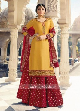Drashti Dhami Yellow Satin Lehenga Suit