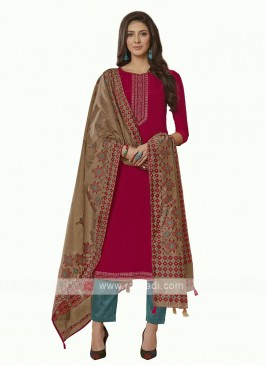 Embroidery suit in rani color
