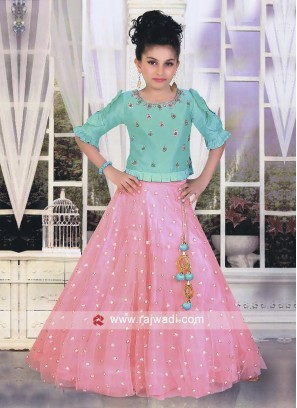 Firozi and pink choli suit with dupatta.