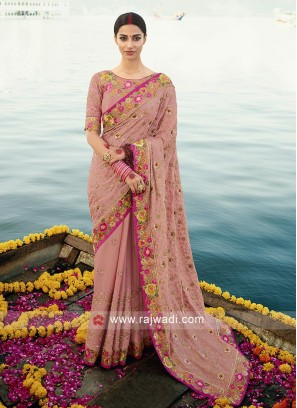 Gajari Pink Chiffon saree with matching blouse.