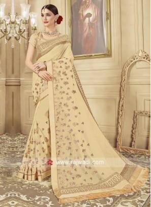 Glass Tissue Saree in Golden Cream