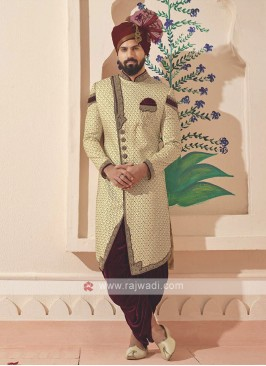 golden and maroon embroidered sherwani