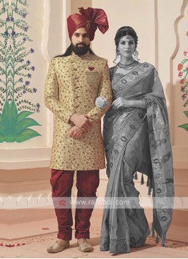 golden and red sherwani