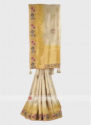 Golden cream and yellow banarasi silk saree