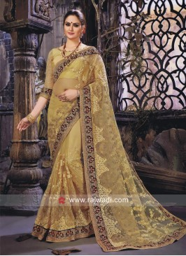 Golden Cream Net Embroidered Saree