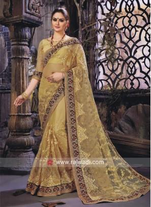Golden Cream Net Embroidered Saree