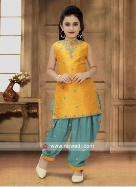 Golden Yellow and green patiala dress.