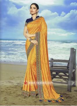 Golden Yellow Art Jacquard Silk saree with Contrast blouse.