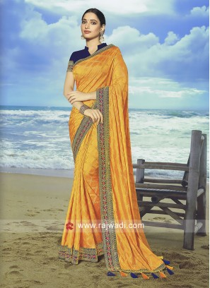 Golden Yellow Art Jacquard Silk saree with Contrast blouse.