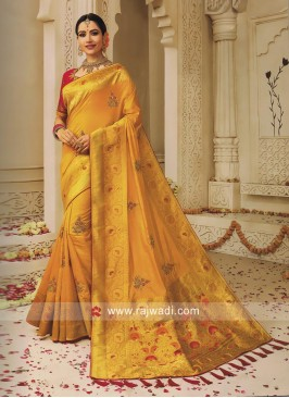 Golden Yellow Heavy Saree with Pink Blouse