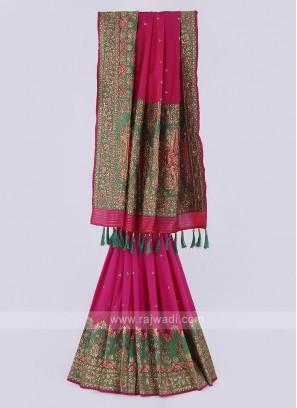 Gorgeous banarasi Silk saree in rani and green color