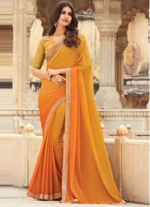 Gratifying Orange Embroidered Silk Shaded Saree