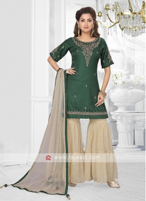green and cream color garara suit