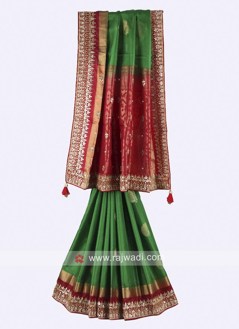 Green and maroon color pure silk saree