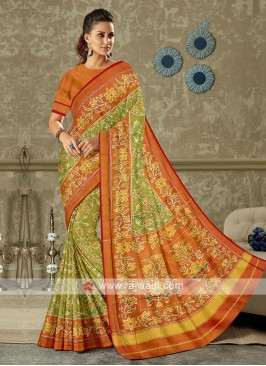 Green and orange color pure silk saree