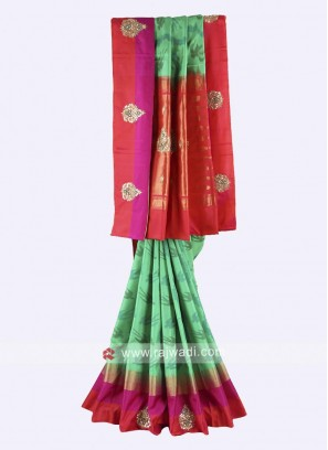 Green and rust color pure silk saree