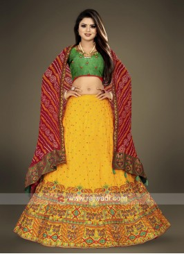green and yellow Lehenga Choli with red dupatta