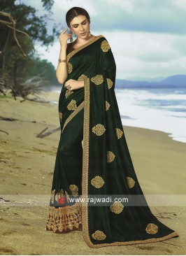 Green Art silk saree with maroon blouse.