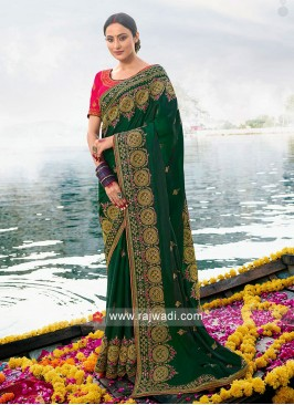 Green Art silk saree with pink blouse.