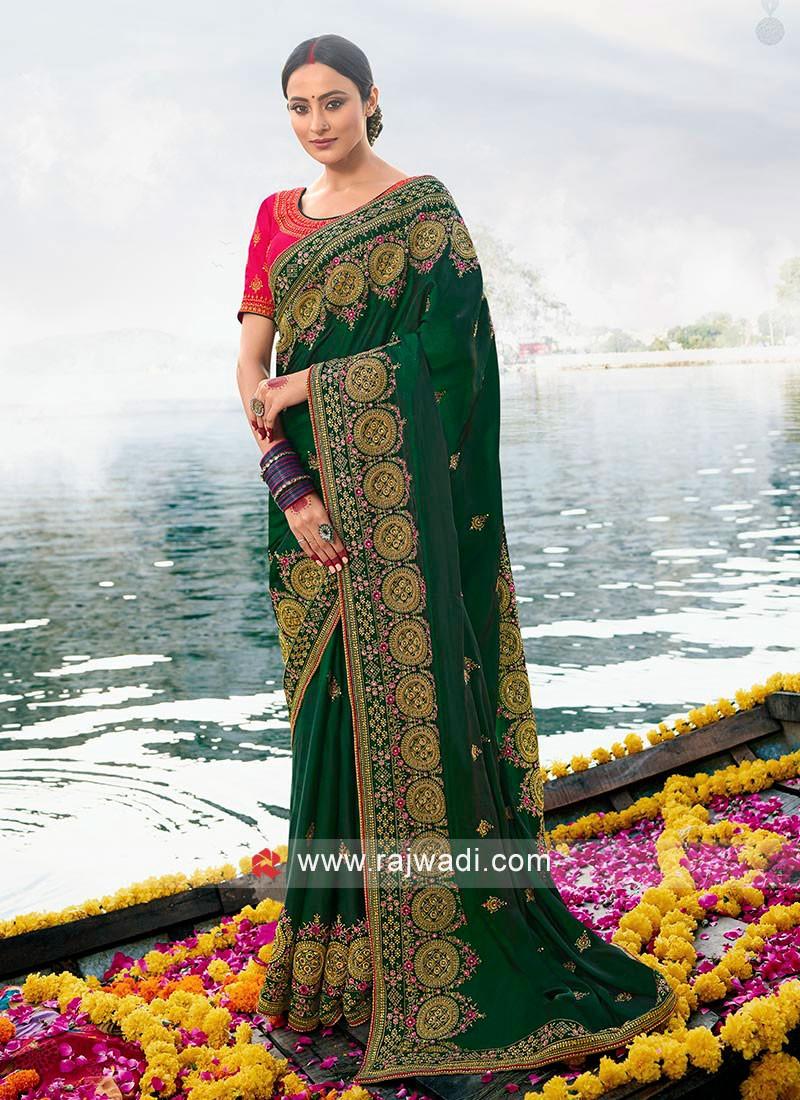 Green Art silk saree with pink blouse.