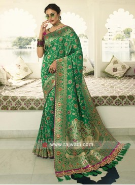 Green banarasi silk saree with blouse.