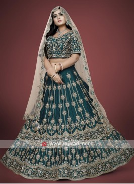 Green choli suit with contrast dupatta.