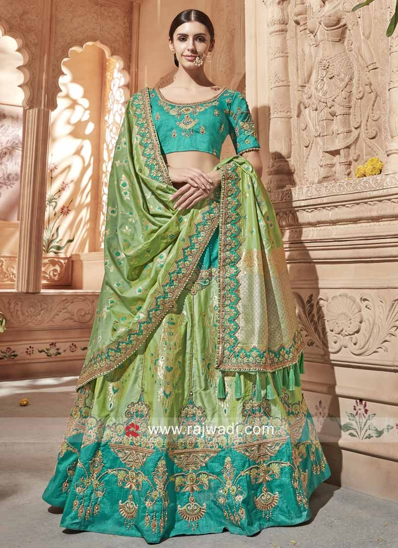 ae073aa22f Green Heavy Embroidered Lehenga. Hover to zoom