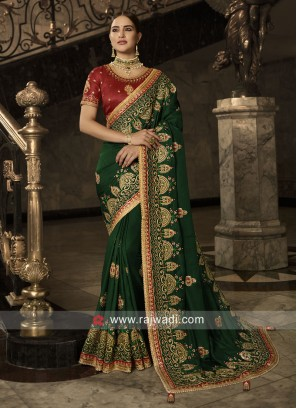 Green Heavy Saree with Red Blouse