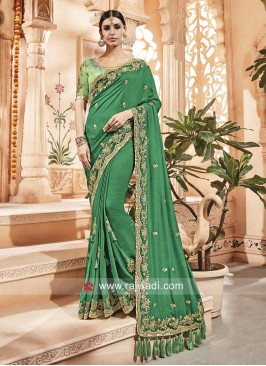 Green Heavy Work Saree with Tassels