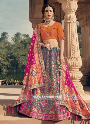 Grey and orange lehenga choli with pink dupatta