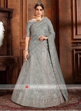 Grey color Lehenga choli with matching dupatta.